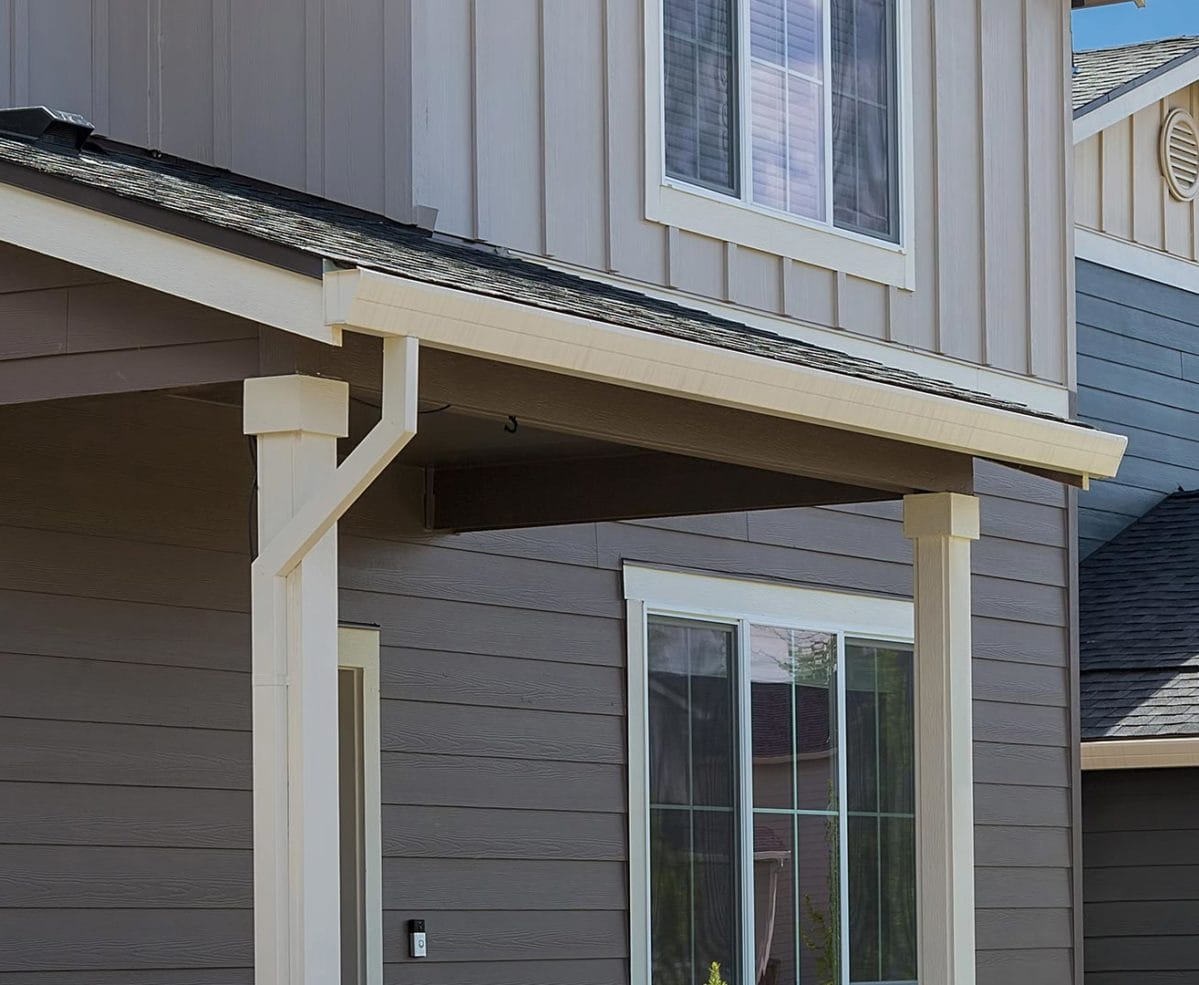 Home with grey siding and white gutters
